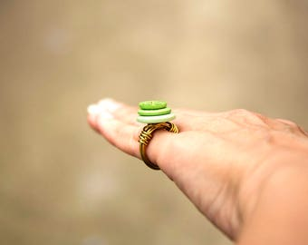Brass wire-wrapped statement ring of stacked decorative buttons in green hues, size I