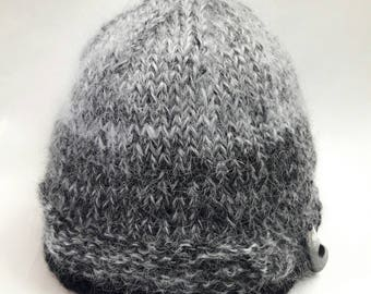 Winter elegant hat of mohair for girls or women in grey and black colors, hand knitted