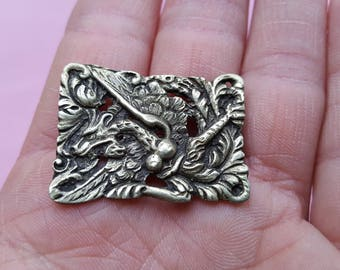 Vintage art deco religious silvered  pin/brooch of a detailed dragon.