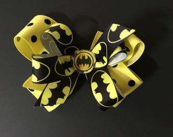 Batman hair bow, hair clip, alligator hair clip, yellow with black polka dot ribbon, and black and yellow Batman ribbon.