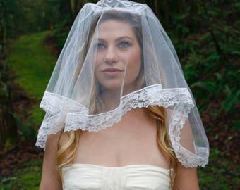 Vintage shoulder length wedding veil with beaded crown