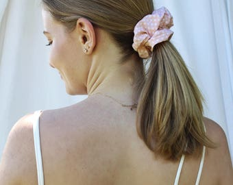 Pink polka dot scrunchie
