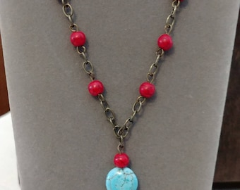 Beaded, chain necklace with feather