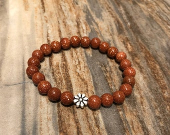 Goldstone Stretch bracelet / available in a wrap / flower accent /