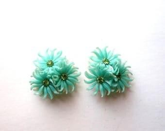signed Kramer earrings . vintage soft plastic flower earrings, clip on with glass rhinestones . seafoam green aqua Lumarith