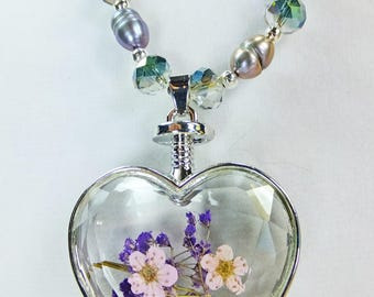 Dried Flowers Pink and Lavender in a Layered Glass Heart Pendant on a Necklace made of Gray Freshwater Pearls and Crystal Beads