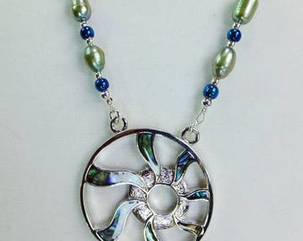 Abalone Shell Inset Sun Ray Pendant with Pale Green Freshwater Pearls, Blue Glass Beads and Tiny Silver Plated Spacer Beads Necklace
