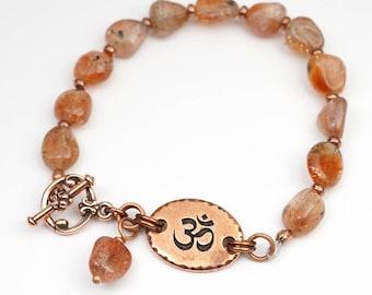 Sunstone bracelet, Tibetan om Zen jewelry, semiprecious stone, golden colors, 7 3/4 inches long