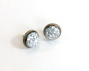 Stud earrings. Silver holographic earrings. Glitter earrings. Glitter resin stud earrings. Fun party jewelry. Festive glittery jewelry.
