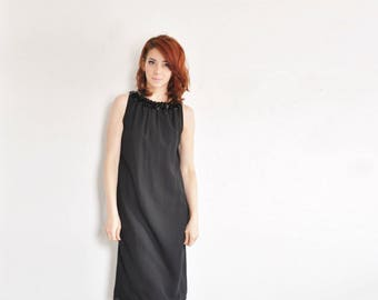 mod black paillette dress . 1960 cocktail party shift . extra long bow tie back .small.medium