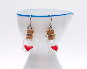 Origami paper heart earrings in tiny glass bottle