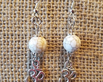 Charming white turquoise drop earring with silver yoga charm