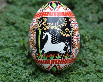 Ornament with horses Pysanka Ukrainian Easter egg batik decorated chicken egg