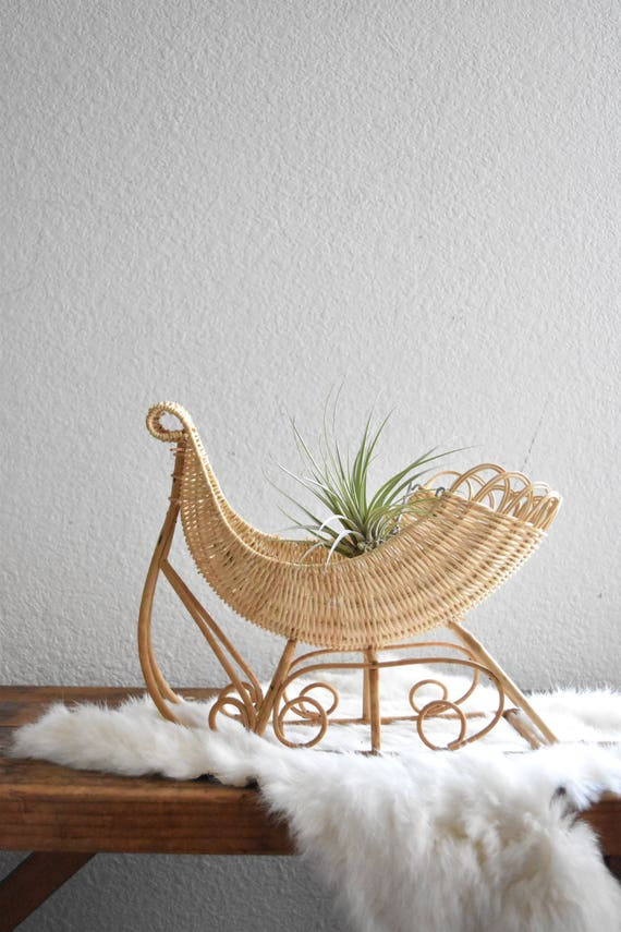 woven wicker christmas sleigh sled basket / santa's sleigh