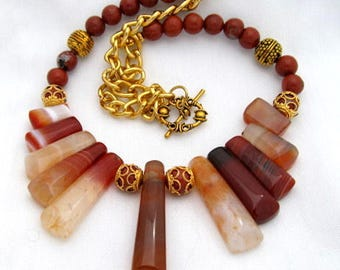 Red Agate bib necklace accented with Jasper beads and gold plated chain with toggle clasp
