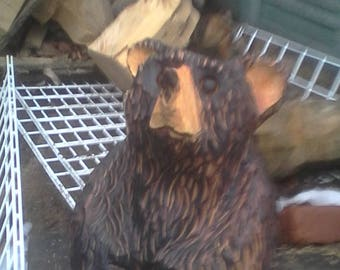 chainsaw carving bear sitting