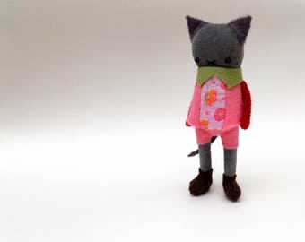 Velvet Cat  -  Handmade plush doll wearing pink felt smock dress with matching shorts.