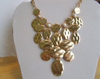 Bib Necklace with Gold Tone Pendants and White Pearls on a Gold Tone Chain