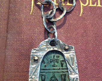 ANCIENT TEXT AMULET holds a copper etched patina hieroglyphic text riveted with a fine silver symbol frame, copper etched back pat gullett