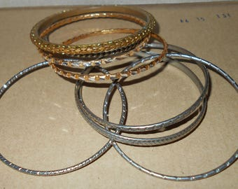 Bangle bracelet lot 8 vintage bracelets mixed metals gold brassy and silver colors 1980s jewelry