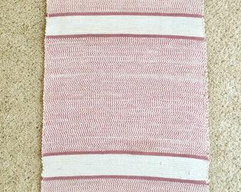 rose and white rag rug