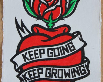 Keep Going Keep Growing - New Rose Edition - a linocut of a heart, banner and rose hand painted on Indian handmade recycled cotton paper