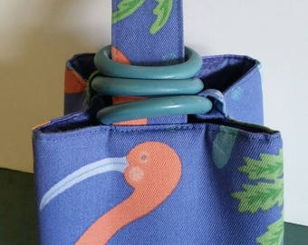 Tropical Ibis And Palm Trio Bag in a vivid blue island-centric cotton, lined in periwinkle blue silk and closed by hand finished wood rings.