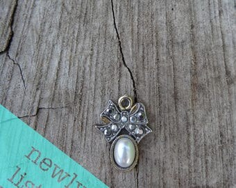 Simulated Pearl Pendant Little Charm Silvertone And Gold Tone Oval With Shaped Bow Cover With Chrome Plated Rhinestones