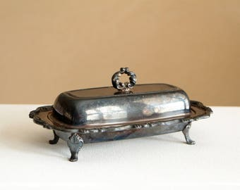 Vintage silver butter dish made by W.M. A Rogers Oneida