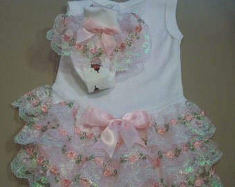 Frilly  baby vest and sock set.