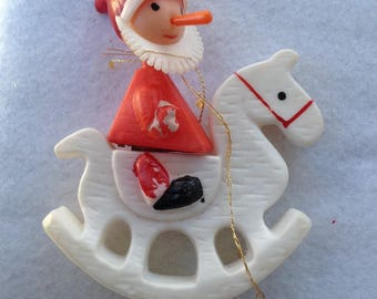 Vintage White plastic rocking horse ornament with santa