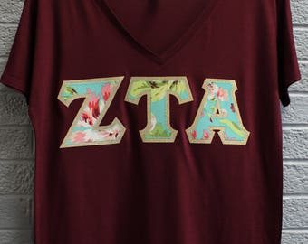 Zeta Tau Alpha Maroon Bella Flowy V-Neck With Amy Butler Bliss Bouquet on Gold Metallic (254C)