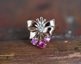 1950s 14K Vintage Retro Diamond and Synthetic Ruby Bow Ring in Rose Gold