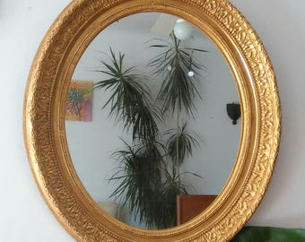Antique mirror, antique oval mirror gilted with gold leaf, French Barbizon frame