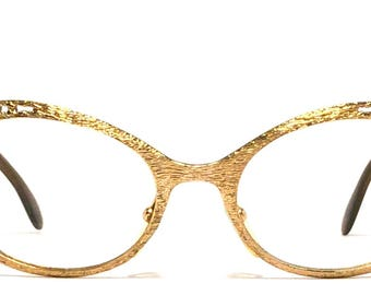 Vintage eyewear. Made in West Germany 1960's. Unique gold finish with cut out detailing! Excellent quality Great condition. Beatnik hip vibe