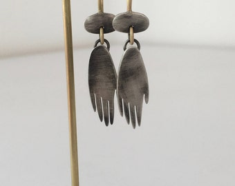 Silver Gold Earrings. Hand and Pebble earrings.