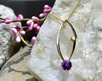 Amethyst set in14k yellow gold hand forged pendant