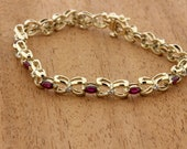 Elegant Ruby Bow and Diamond Bracelet 14K Yellow Gold