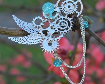 Steampunk gears and wings-inspired brooch