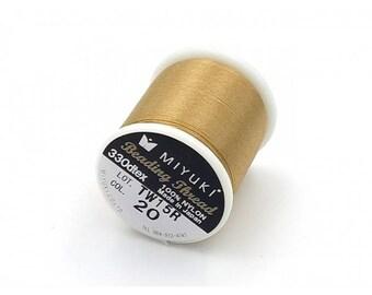 Spool of thread Miyuki 100% nylon color champagne gold
