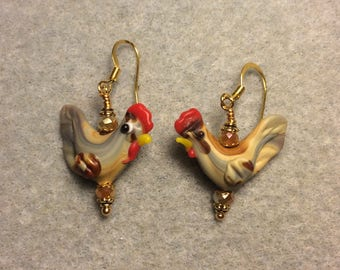 Tan lampwork chicken bead earrings adorned with tan Chinese crystal beads.