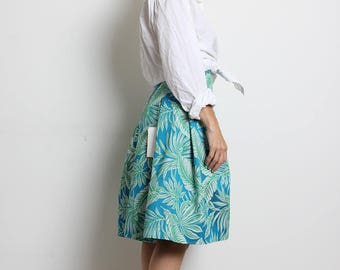 Tropical print pleated knee length skirt