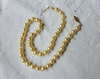 "16"" faux champagne pearl strand"