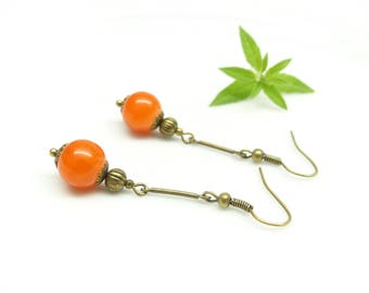 . • • Oriental Lantern. Thin Orange earrings. Dangling earrings orange bead.