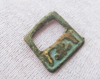 Ancient bronze belt buckle with enamels