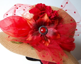 Chic hat in warm colors with red and green flowers
