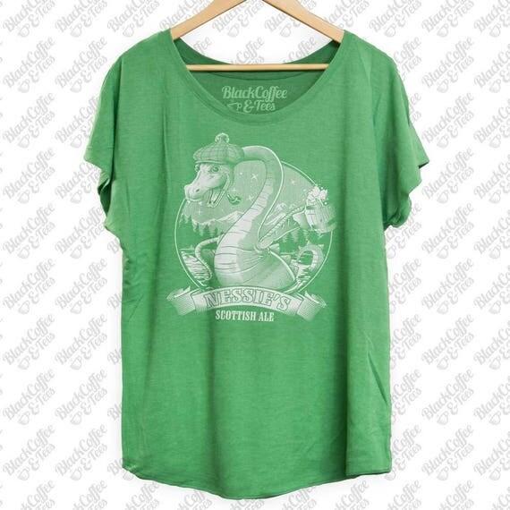 St Patricks Day Shirt - Loch Ness Monster Shirt - Nessie The Loch Ness Monster Drinking Scottish Ale Screen Printed on a Womens Green Dolman