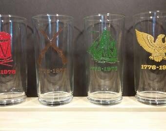 Set of Four Vintage Bicentennial Celebration Tumbler Glasses Drum, Eagle, Ship, and Rifles