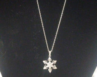 Sterling silver necklace with snowflake pendant