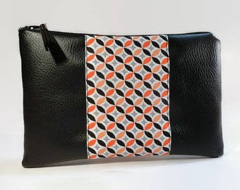 flat pouch in black imitation leather and fabric with geometric black and orange flowers